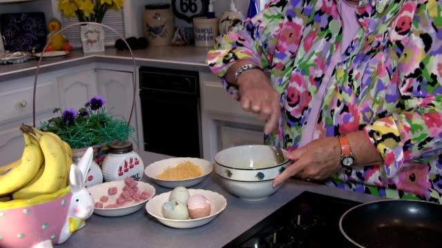 Grandma fixes breakfast - zoom in video
