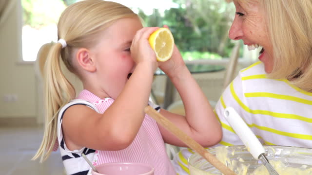 Grandmother And Granddaughter Baking Together video