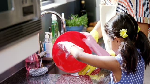 Grandmother and granddaughter washing dishes in the sink 4K 4k Happy grandmother and granddaughter washing dishes in the sink 4K 4k chores stock videos & royalty-free footage