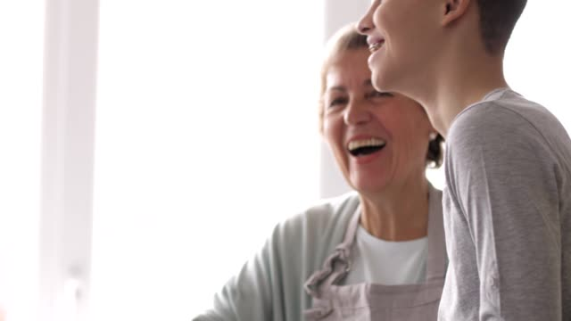 Grandmother and grandson laughing