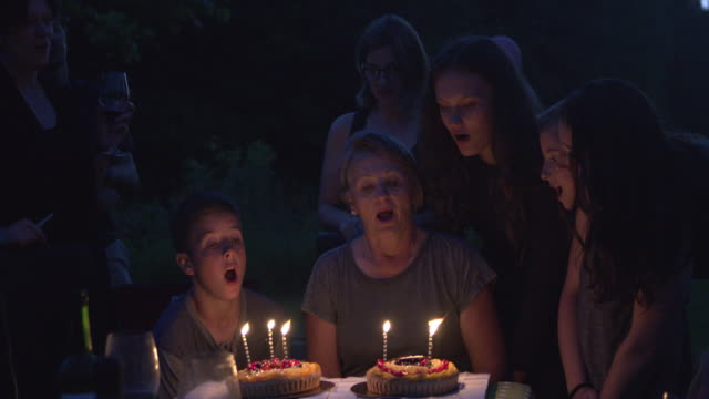 Grandmother Birth Party Big Family Outdoor at Night with Cake and Candles video