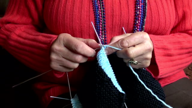 grandmother hands knitting new sweater video