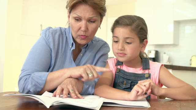 Grandmother Helping Granddaughter With Homework video