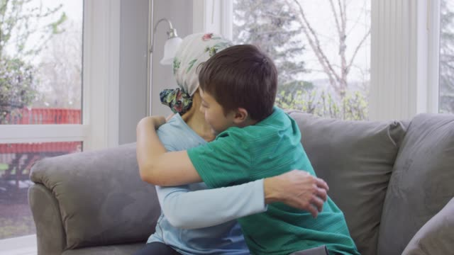 grandmother recovering from cancer receives a hug - breast cancer awareness filmów i materiałów b-roll