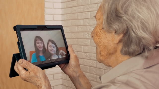 Grandmother talks to grandchildren on the Internet Grandmother talks to grandchildren on the Internet. zoom call stock videos & royalty-free footage
