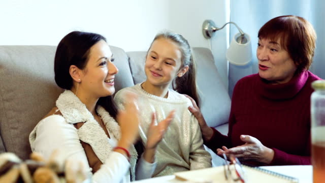 Grandmother with daughter and granddaughter  at home video