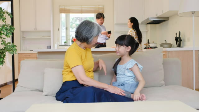Grandmother With Her Granddaughter in a Home in Taiwan A Taiwanese grandmother spends time with her granddaughter in a home in Taipei. child care stock videos & royalty-free footage