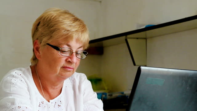 grandmother working on laptop video