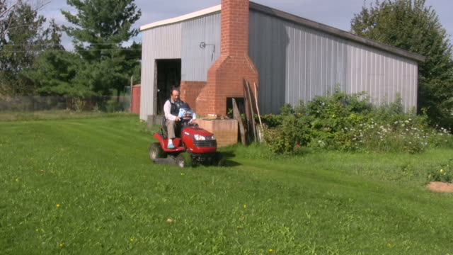 Grandpa and Grandson Mowing video