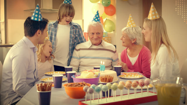 Grandpa blowing out the candles on birthday cake video