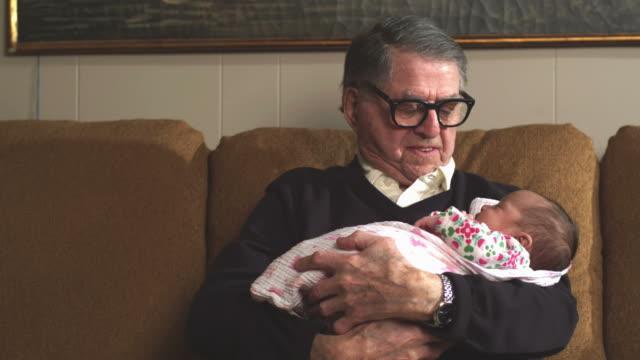 Grandpa holds baby video
