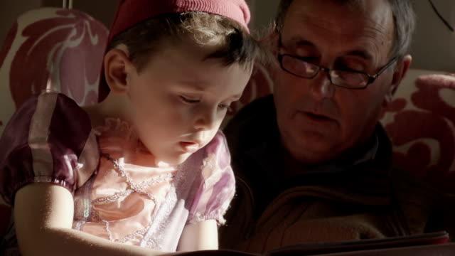 Grandpa Reading A Story To His Grandchildren video