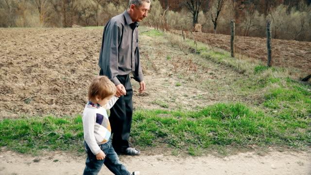 Grandpa walks with grandson video