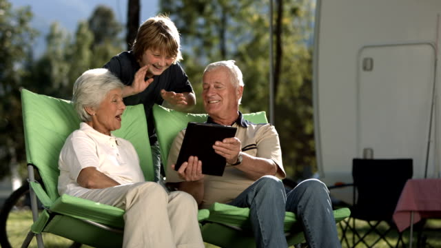 SLO MO Grandparents And Grandson Video Chatting video
