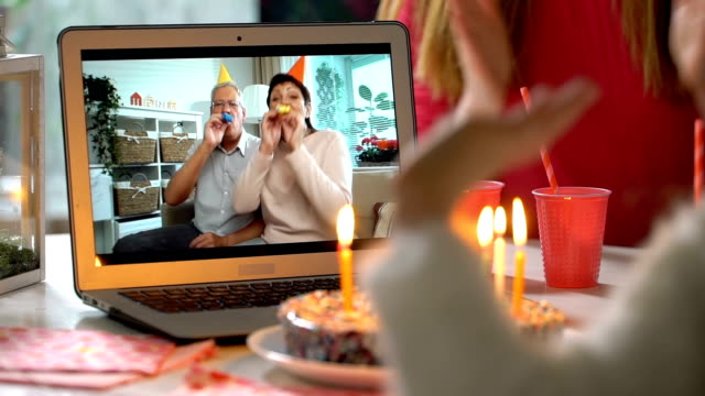 vídeos de stock e filmes b-roll de grandparents congratulate their grandchildren happy birthday using laptop video call - aniversário