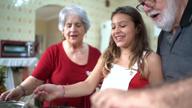 Grandparents Teaching Their Grandchild How to Cook Domestic Life granddaughter stock videos & royalty-free footage