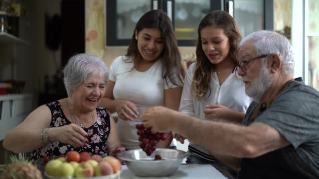 Grandparents with Their Grandchild in the Kitchen at Home Doing activities at home cousin stock videos & royalty-free footage