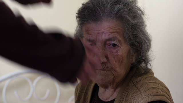 grandson man kissing very old senior woman grandmother video