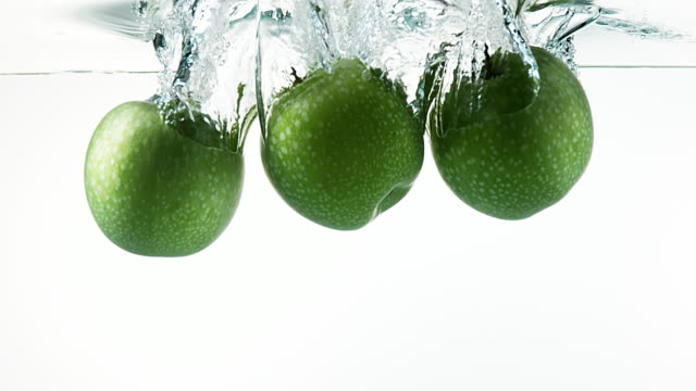 Granny Smith Apples, malus domestica, Fruit entering Water against White Background, Slow Motion 4K Granny Smith Apples, malus domestica, Fruit entering Water against White Background, Slow Motion 4K apple fruit stock videos & royalty-free footage