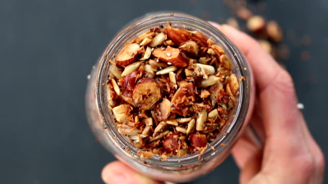 granola homemade - gluten free stock videos and b-roll footage