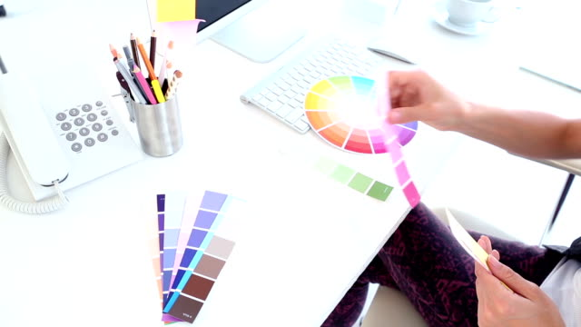 Graphic designer looking at colour samples video