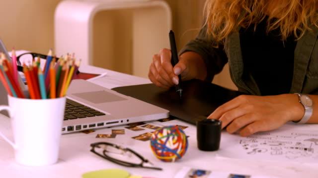 Graphic designer using digitizer at her desk video