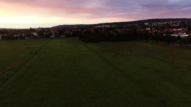 Grass Field Near Town Aerial During Sundown video