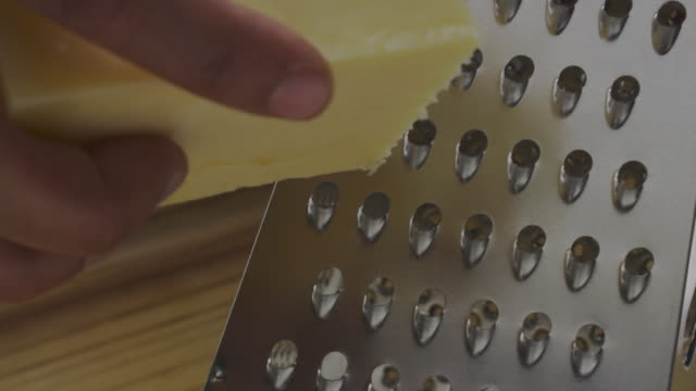 grating cheese - articoli casalinghi video stock e b–roll