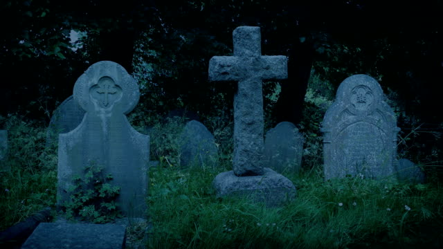 Gravestones In The Churchyard In The Evening