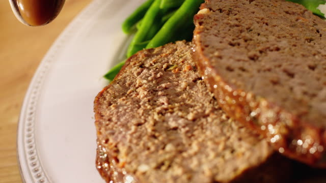Gravy pouring over meat loaf