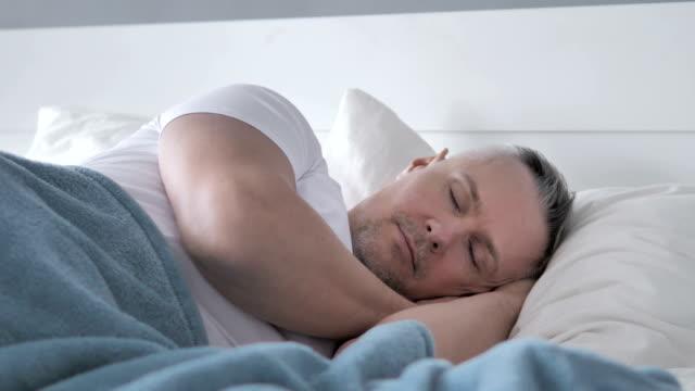 Gray Hair Man Sleeping in Bed Gray Hair Man Sleeping in Bed man sleeping stock videos & royalty-free footage