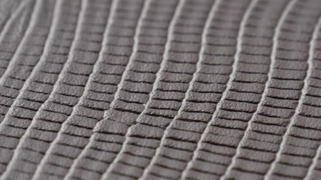 stockvideo's en b-roll-footage met grijze lederen textuur oppervlak echte achtergrond close-up. - dierenhuid huid