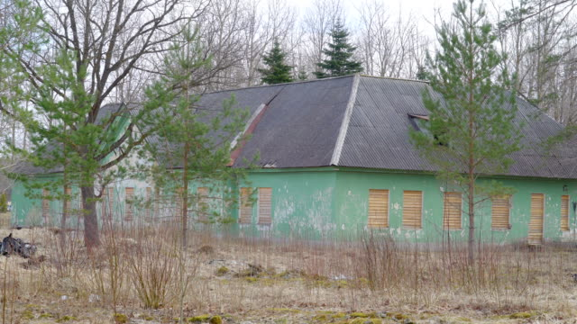 A gray roof green house in the field video