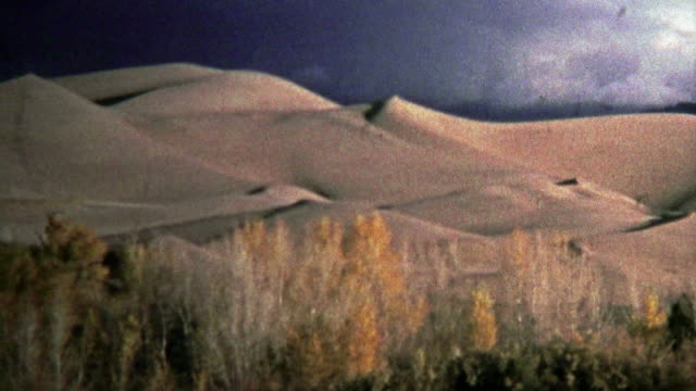 SAN LUIS VALLEY, CO. USA -1972: Great Sand Dunes National Park showcases glowing sand. video