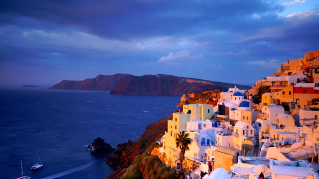 Great twilight view of Santorini island Great twilight view of Santorini island. Sunset on the famous Oia city, Greece, Europe greek islands stock videos & royalty-free footage