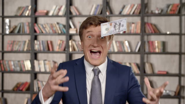 Great Winning! Slow Motion Portrait of Very Happy Successful Cheering Man Throwing Money Up, Rising Hands Celebrating His Successful Win With a Lot of Dollars. Businessman Series.