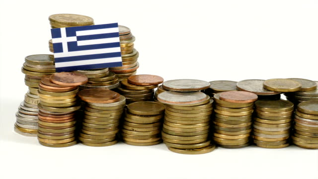 greece flag with stack of money coins - grecia stato video stock e b–roll