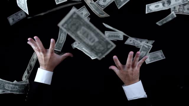Greedy Businessman Catching Money (Super Slow Motion) video