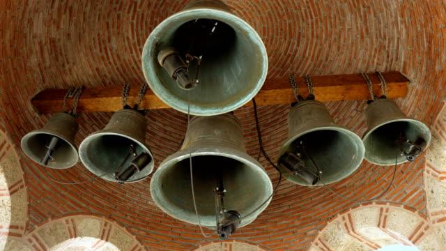 Greek belfry with six bells on church. Orthodox Meteora monasteries. Greece. 4K