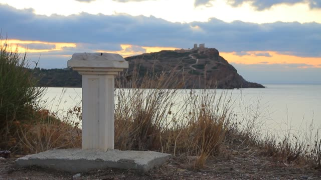 Greek column and Poseidon temple, Cape Sounio Greece Cape Sounion. Single greek column on sea shore and ruins of an ancient temple of Poseidon in the background time lapse sounion stock videos & royalty-free footage