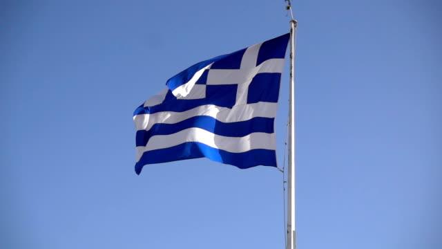 Greek flag waving against the blue sky video