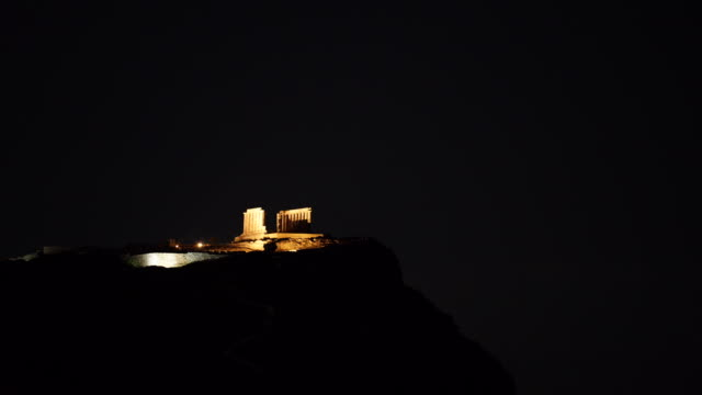 Greek temple of Poseidon at night, Cape Sounio Night scene ruins of an ancient temple of Poseidon, Greek god of the sea. Greece Cape Sounion. sounion stock videos & royalty-free footage