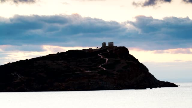 Greek temple of Poseidon at sunrise, Cape Sounio Greece Cape Sounion. Ruins of an ancient temple of Poseidon at morning sunrise, view from distance, time lapse sounion stock videos & royalty-free footage