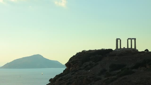 Greek temple of Poseidon, Cape Sounio. Time lapse. Greece Cape Sounion. Ruins of an ancient temple of Poseidon, time lapse. sounion stock videos & royalty-free footage