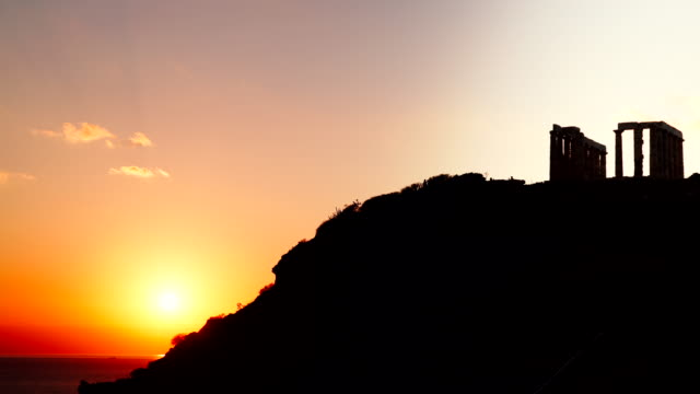 Greek temple of Poseidon, Cape Sounio Greece Cape Sounion. Ruins of an ancient temple of Poseidon, Greek god of the sea, at sunset, time lapse 4K sounion stock videos & royalty-free footage