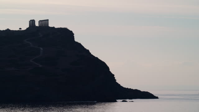 Greek temple of Poseidon, Cape Sounio Greece Cape Sounion. Ruins of an ancient temple of Poseidon, Greek god of the sea, at morning, time lapse 4K sounion stock videos & royalty-free footage