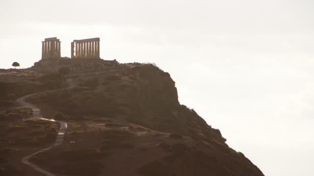 Greek temple of Poseidon, Cape Sounio Greece Cape Sounion. Ruins of an ancient temple of Poseidon, Greek god of the sea 4K sounion stock videos & royalty-free footage