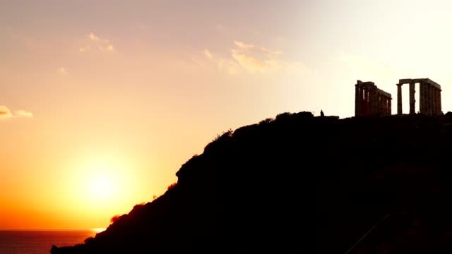 Greek temple of Poseidon, Cape Sounio Greece Cape Sounion. Ruins of an ancient temple of Poseidon, Greek god of the sea, at sunset, time lapse 4KGreece Cape Sounion. Ruins of an ancient temple of Poseidon, Greek god of the sea, at sunset, time lapse 4K sounion stock videos & royalty-free footage