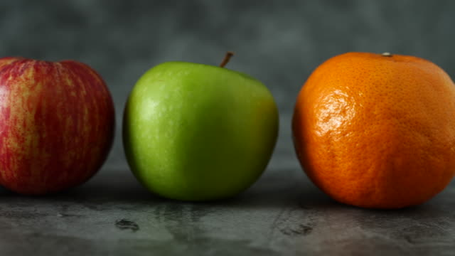Green apple, mixed fruit with oranges, healthy red apples and oranges, fresh fruit