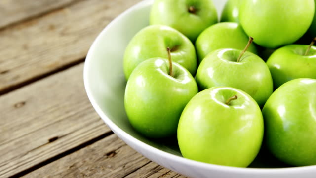 Green apples arranged in bowl video